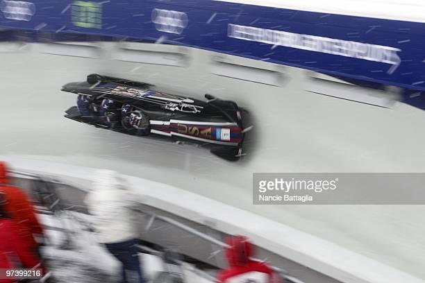 2010 Winter Olympics USA Team 1 Steven Holcomb Steve Mesler Curtis Tomasevicz Justin Olsen in action during Four Man Bobsled at Whistler Sliding...