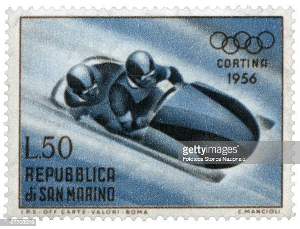 Bobsleigh at two Postage stamp from the series dedicated by the Postal Service of the Republic of San Marino to sports practiced in the 7th Winter...