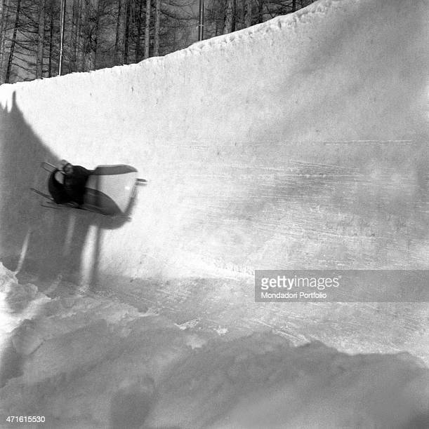 A bobsleigh driver competing in a race at the VII Olympic Winter Games Cortina d'Ampezzo 1956