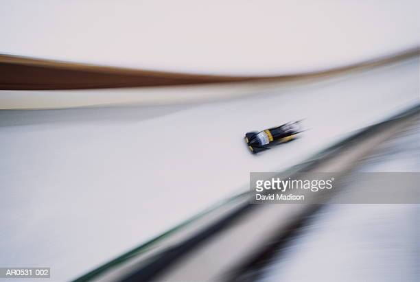 bob-sleigh on race track (blurred motion) - bobsleigh stock pictures, royalty-free photos & images