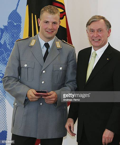 Bobsleigh pilot Andre Lange receives an award from German President Horst Koehler during the ceremony of the 'Silbernes Lorbeerblatt' awards at...