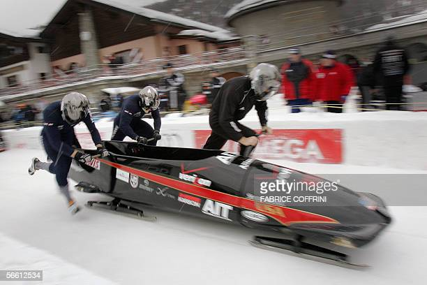 Bobsleigh pilot Todd Hays of the USA and teammates Pavle Jovanovic Steve Mesle and Brock Kreitzburg push their sled 18 January 2006 at the start of...