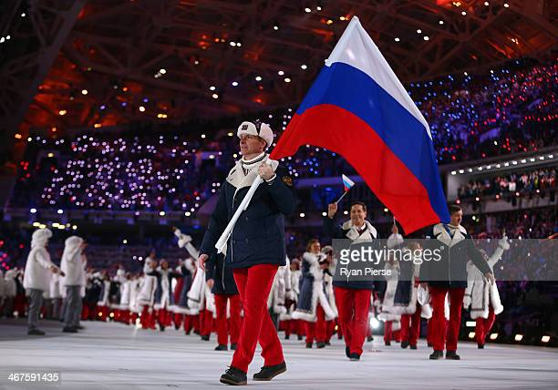 Bobsleigh racer Alexander Zubkov of the Russia Olympic team carries his country's flag during the Opening Ceremony of the Sochi 2014 Winter Olympics...