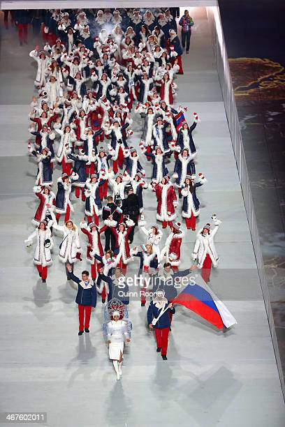 Bobsleigh racer Alexander Zubkov of the Russia Olympic team carries his country's flag alongside model Irina Shayk during the Opening Ceremony of the...