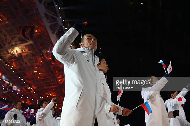Bobsleigh racer Hiroatsu Takahashi of the Japan Olympic team enters the stadium during the Opening Ceremony of the Sochi 2014 Winter Olympics at...
