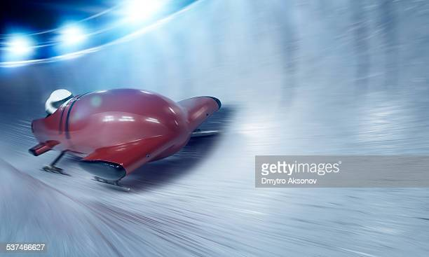bobsleigh team at night - bobsleigh stock pictures, royalty-free photos & images
