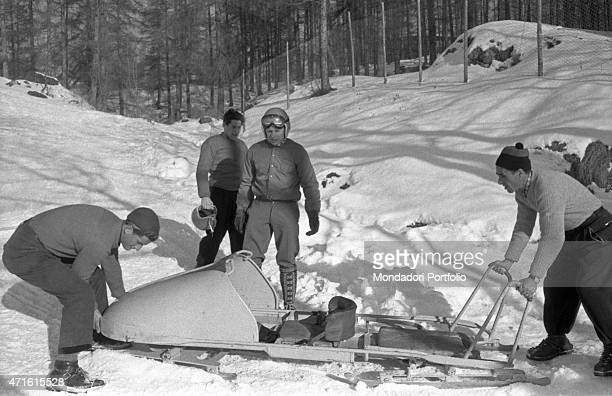 A bobsleigh team getting ready for a race at the VII Olympic Winter Games Cortina d'Ampezzo 1956