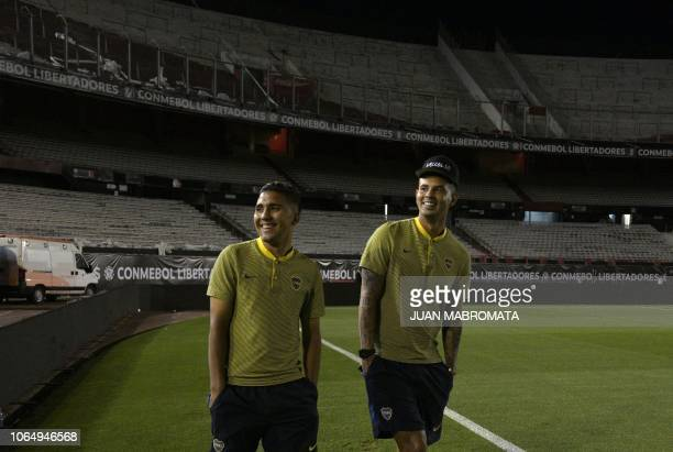 Boca Juniors' Agustin Almendra and Colombian teammate Edwin Cardona are seen on the field of the Monumental stadium in Buenos Aires after authorities...