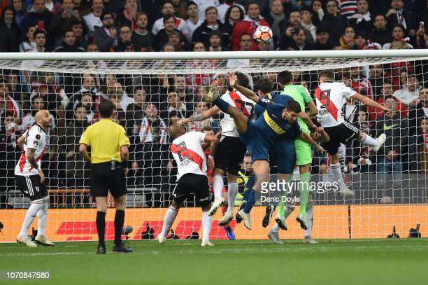 Boca Juniors and River Plate player compete for the ball as Boca Juniors take a corner during the second leg of the final match of Copa CONMEBOL...