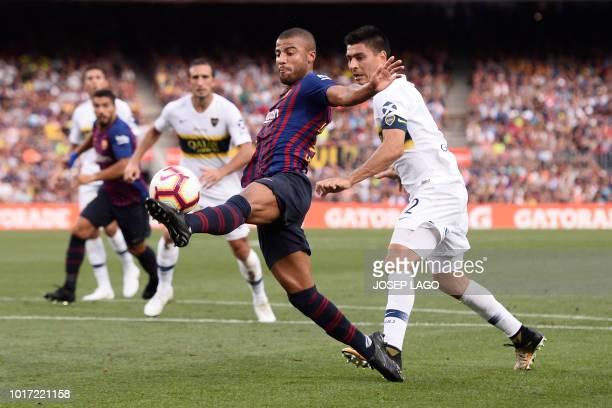 Boca Juniors' Argentinian defender Paolo Goltz challenges Barcelona's Brazilian midfielder Rafinha during the 53rd Joan Gamper Trophy friendly...