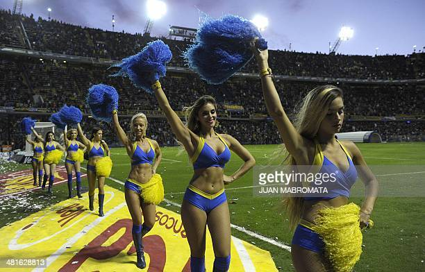 Boca Juniors' cheerleaders perform before the Argentine first division football match against River Plate at La Bombonera stadium in Buenos Aires...