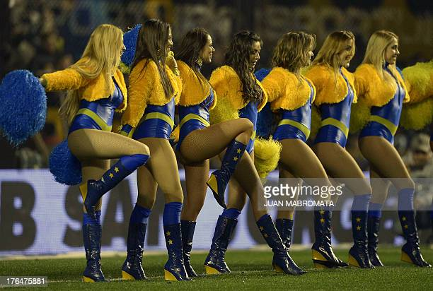 Boca Juniors' cheerleaders perform during half time of the Argentine first division football match against Newell'S Old Boys at La Bombonera stadium...