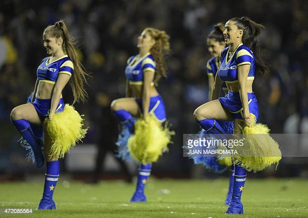 Boca Juniors' cheerleaders perform during the Argentine first division football match against River Plate at La Bombonera stadium in Buenos Aires...