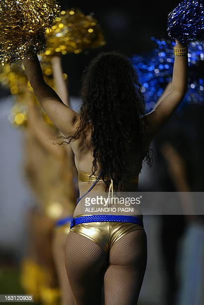 Boca Juniors' cheerleaders perform during the half time of the Argentine First Division football match against San Martin at the Bombonera stadium in...