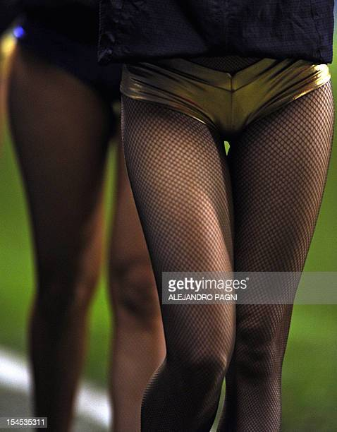 Boca Juniors' cheerleaders perform during the half time of the Argentine First Division football match against Estudiantes at the Bombonera stadium...