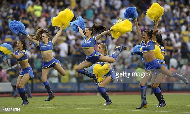 Boca Juniors' cheerleaders perform during the half time of the Argentine first division football match against Olimpo at La Bombonera stadium in...