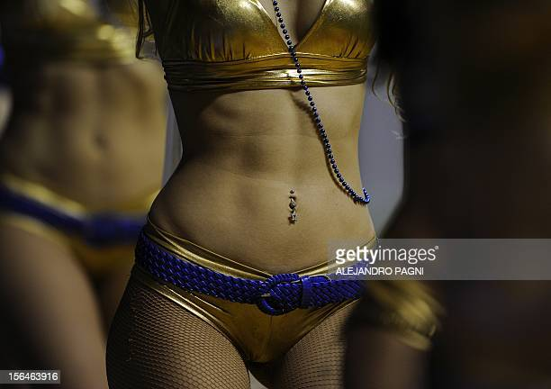 Boca Juniors' cheerleaders perform during the halftime of the Argentine First Division football match against Newell's Old Boys at Bombonera stadium...