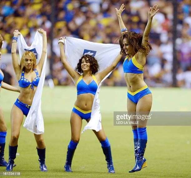 Boca Juniors' cheerleaders perform during the halftime of the Argentinian first division football match against Quilmes at La Bombonera stadium in...
