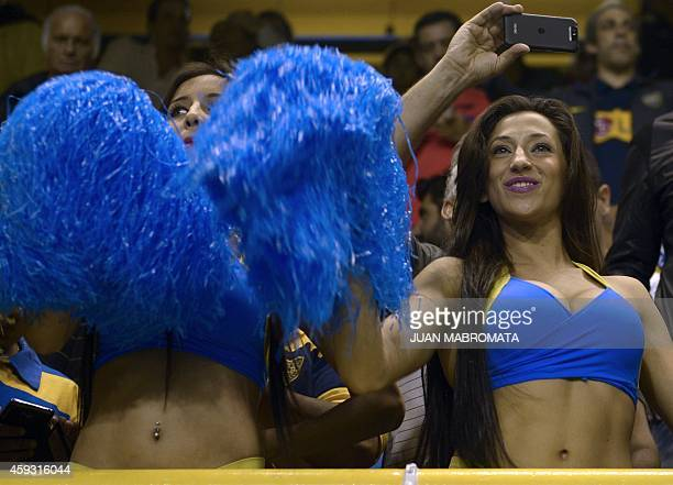Boca Juniors' cheerleaders perform during the Sudamericana Cup semifinal first leg football match at against River Plate at the Bombonera stadium in...