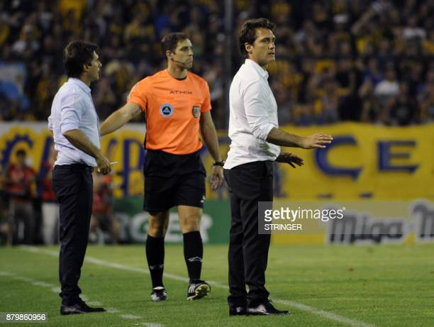Boca Juniors' coach Guillermo Barros Schelotto and his brother and assistant Gustavo gesture during their Argentina's Superliga first division...