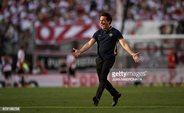 Boca Juniors' coach Guillermo Barros Schelotto celebrates after forward Ricardo Centurion scored the team's fourth goal against River Plate during...