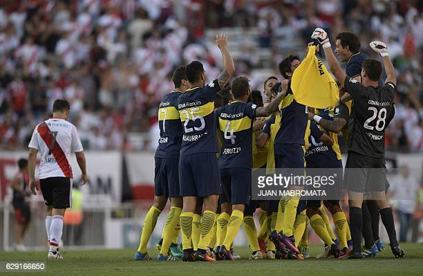 Boca Juniors' coach Guillermo Barros Schelotto celebrates with teammates after Boca Juniors defeated River Plate in their Argentine first division...