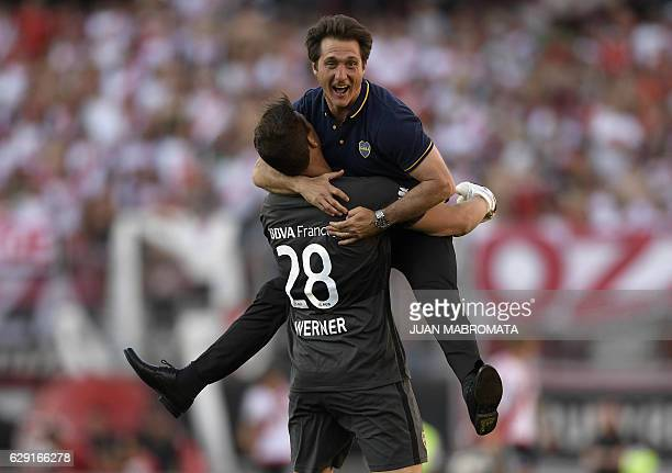 Boca Juniors' coach Guillermo Barros Schelotto celebrates with gaolkeeper Axel Werner after forward Ricardo Centurion scored the team's fourth goal...