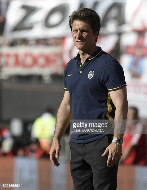 Boca Juniors' coach Guillermo Barros Schelotto gestures during the Argentine first division football match against River Plate at the Monumental...