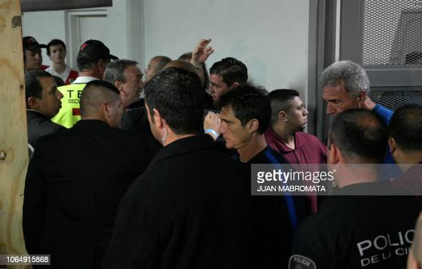 Boca Juniors' coach Guillermo Barros Schelotto is seen at the Monumental stadium in Buenos Aires after checking the damages on the team's bus after...