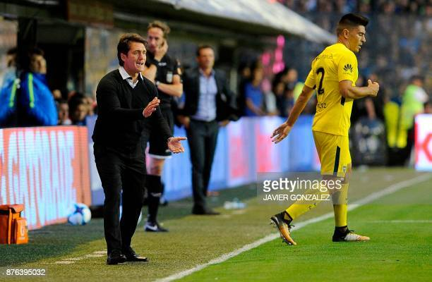 Boca Juniors' coach Guillermos Barros Schelotto gives directions during the match between Boca Juniors and Racing Club in the Superliga first...
