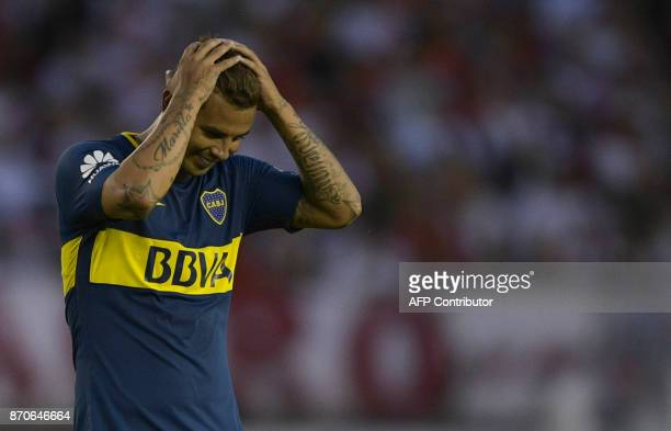 Boca Juniors' Colombian midfielder Edwin Cardona reacts after being sentoff by referee Nestor Pitana during the Argentine derby match against River...