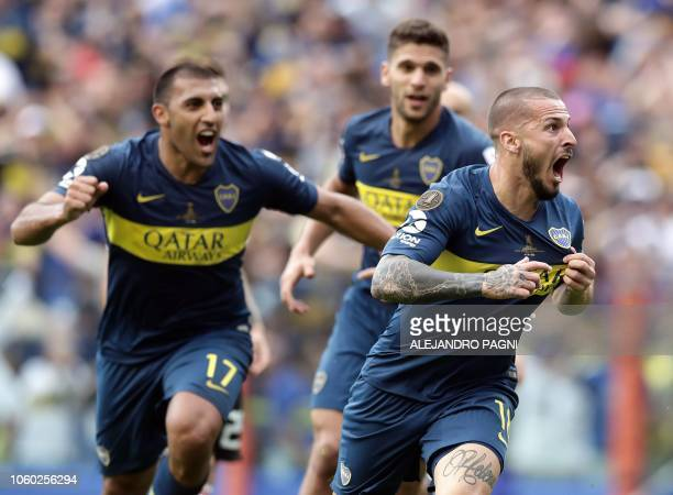 Boca Juniors' Dario Benedetto celebrates after scoring the team's second goal against River Plate during their first leg match of the allArgentine...