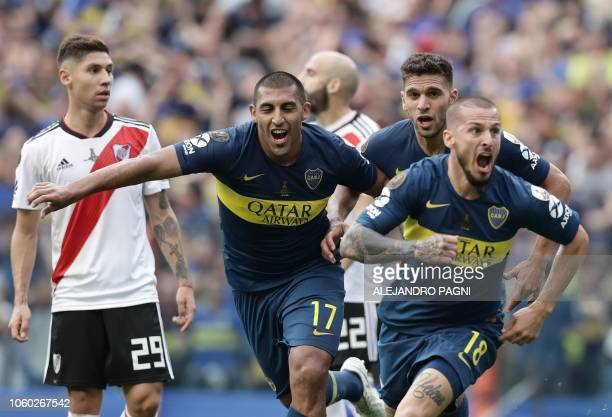 TOPSHOT Boca Juniors' Dario Benedetto celebrates after scoring the team's second goal against River Plate during their first leg match of the...