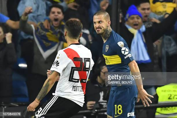 TOPSHOT Boca Juniors' Dario Benedetto celebrates next to River Plate's Uruguayan Gonzalo Montiel after scoring during the second leg match of their...
