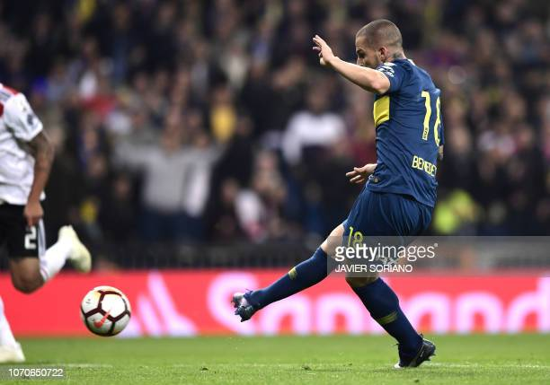 Boca Juniors' Dario Benedetto strikes the ball to score against River Plate during the second leg match of their allArgentine Copa Libertadores final...