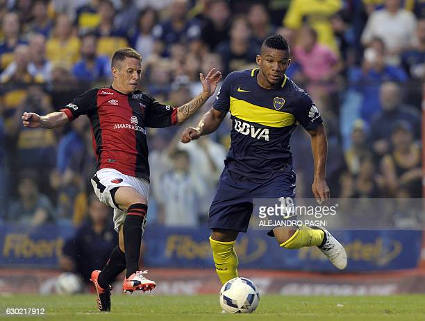 Boca Juniors' defender Frank Fabra vies for the ball with Colon's Nicolas Silva during their Argentina First Division football match at La Bombonera...