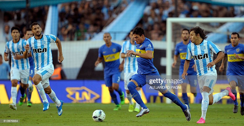 Boca Juniors defender Jonathan Silva (C) controls the ball past Racing Club midfielder Oscar Romero (2nd-R) during their Argentina First Division football match at Presidente Peron stadium in Avellaneda, Buenos Aires, on February 28, 2016.