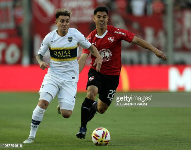 Boca Juniors' defender Julio Buffarini drives the ball past Independiente's midfielder Francisco Silva during their Argentina First Division...