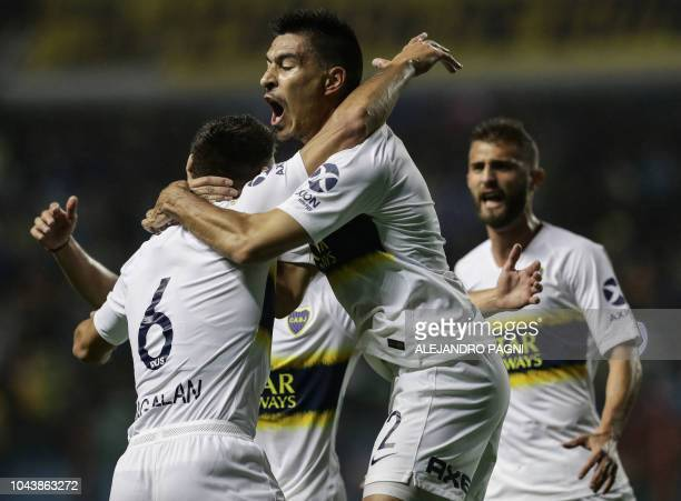 Boca Juniors' defender Lisandro Magallan celebrates after scoring a goal against Colon during their Argentina First Division Superliga football match...