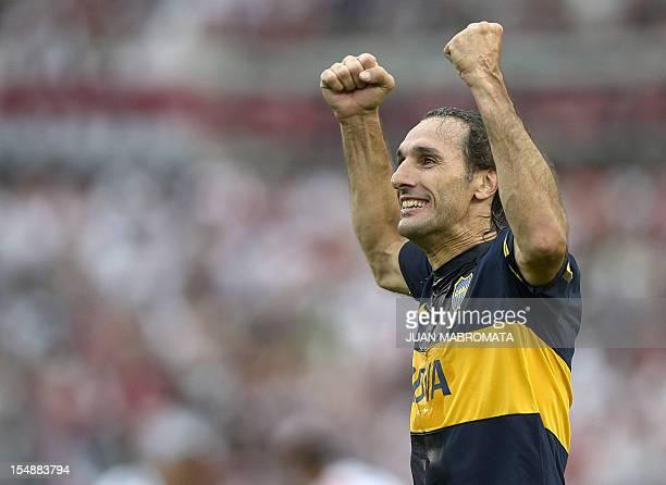 Boca Juniors' defender Rolando Schiavi celebrates his team´s second goal scored by teammate Walter Erviti against River Plate during their Argentine...