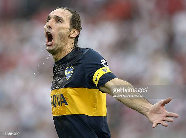 Boca Juniors' defender Rolando Schiavi celebrates his team's second goal scored by teammate Walter Erviti against River Plate during their Argentine...