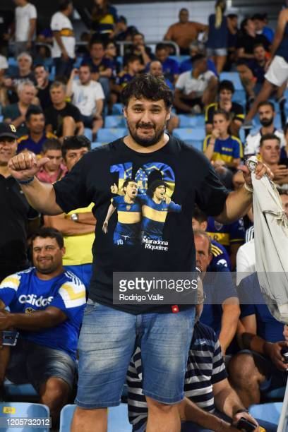 Boca Juniors fan displays a shirt of Diego Maradona and Juan Roman Riquelme during a match between Boca Juniors and Gimnasia as part of Superliga...