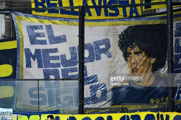 Boca Juniors fans display a flag of Diego Maradona during a match between Boca Juniors and Gimnasia as part of Superliga 2019/20 at Estadio Alberto J...