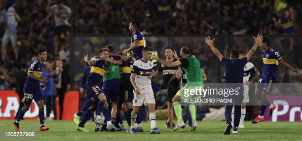 Boca Juniors' footballers celebrate after winning the Argentina First Division 2020 Superliga Tournament after defeating Gimnasia y Esgrima by 10 at...