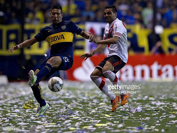 Boca Juniors' forward Andres Chavez vies for the ball with River Plate's defender Gabriel Mercado during the Copa Sudamericana 2014 semifinal first...