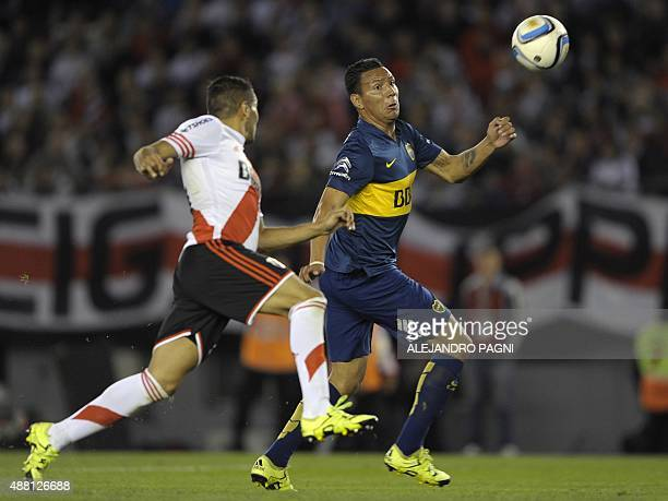 Boca Juniors' forward Andres Chavez vies for the ball with River Plate's defender Gabriel Mercado during their Argentina First Division football...