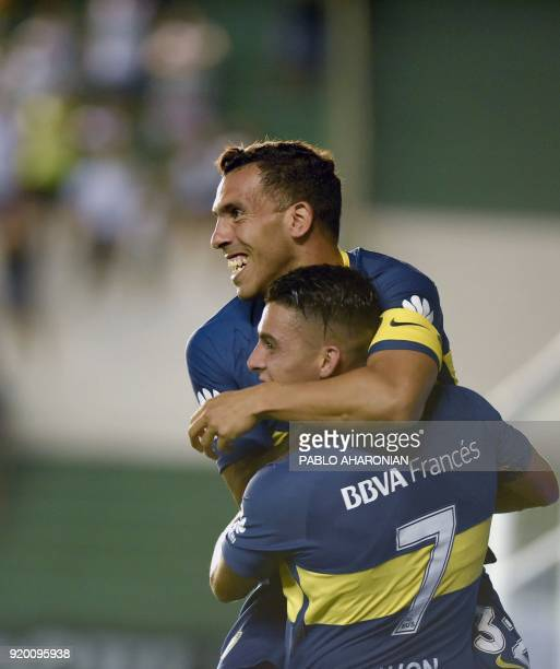 Boca Juniors' forward Carlos Tevez celebrates after scoring a goal against Banfield during their Argentina First Division Superliga football match at...