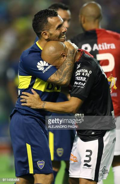 Boca Juniors' forward Carlos Tevez hugs Colon's defender Clemente Rodriguez during their Argentina First Division Superliga football match at La...