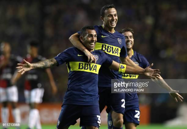 Boca Juniors' forward Carlos Tevez midfielder Gonzalo Maroni and defender Julio Buffarini celebrate after Uruguayan midfielder Nahitan Nandez scores...