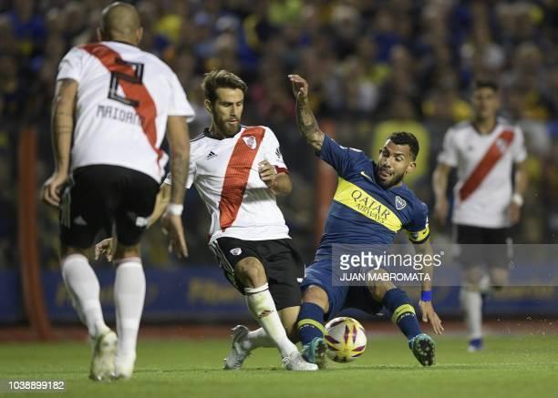 Boca Juniors' forward Carlos Tevez vies for the ball with River Plate's midfielder Leonardo Ponzio during their Argentine first division Superliga...